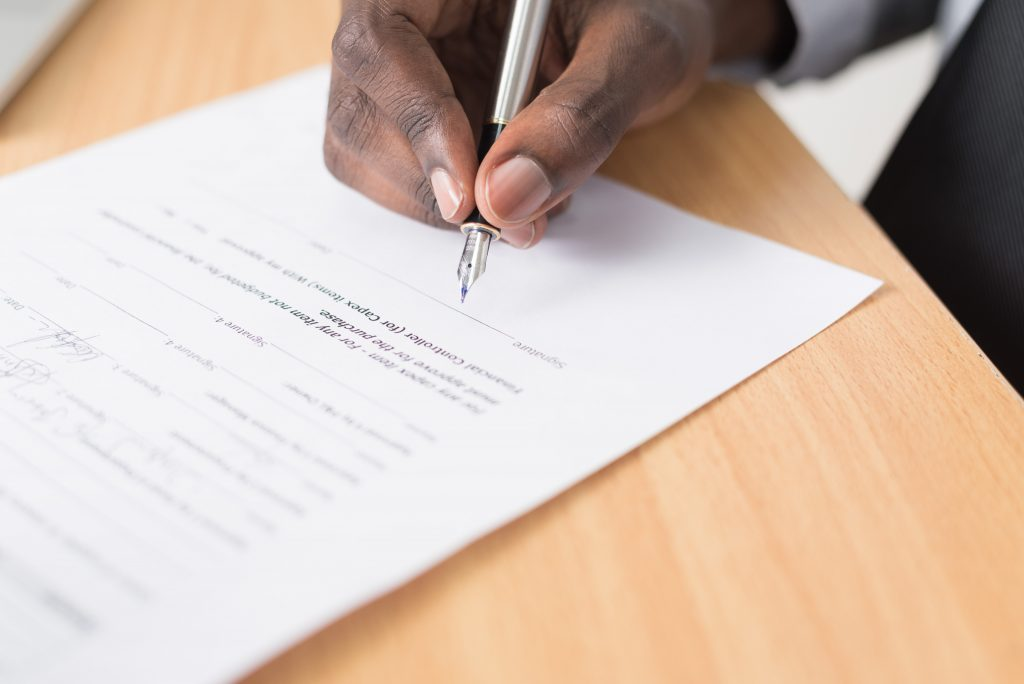 businessman signing a document in a contract dispute case