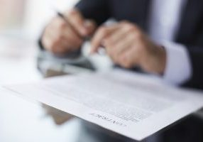 Shallow dof image of a businessman signing the contract